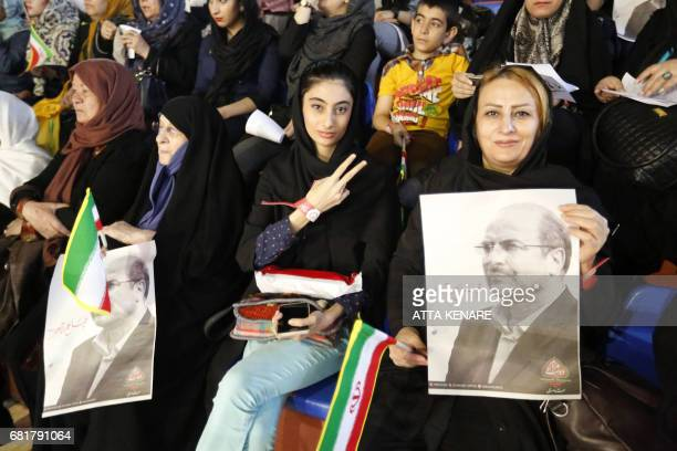 Supporters of Iranian conservative presidential candidate Tehran mayor Mohammad Bagher Ghalibaf hold his portrait during a campaign rally in the...