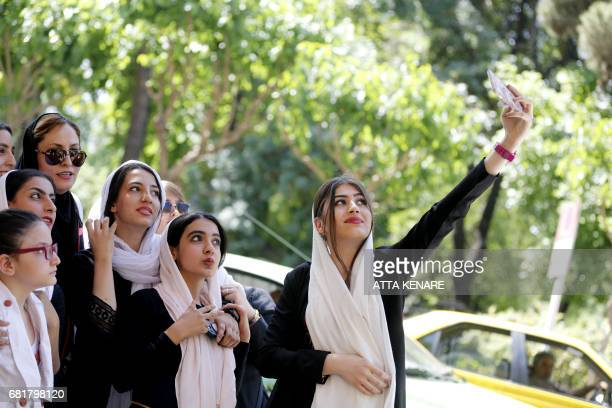 Supporters of Iranian conservative presidential candidate Tehran mayor Mohammad Bagher Ghalibaf pose for a selfie during a campaign rally in the...