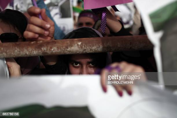 Supporters of Iranian President and candidate in the upcoming presidential elections Hassan Rouhani cheer during a campaign rally in the southwestern...