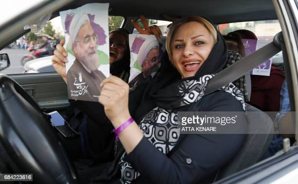 Supporters of Iranian President and election candidate Hassan Rouhani distribute brochures ahead of the Iranian presidential election in the streets...