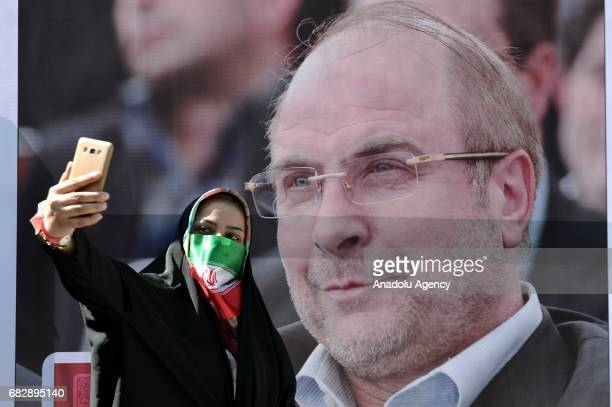Supporters of Iranian presidential candidate and Mayor of Tehran Mohammad Bagher Ghalibaf attend electoral Ghalibaf's rally prior to presidential...
