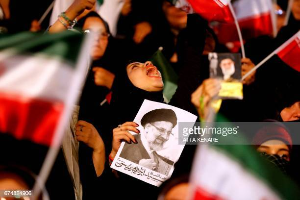 Supporters of Iranian presidential candidate Ebrahim Raisi attend a campaign rally in the capital Tehran on April 29 2017 / AFP PHOTO / ATTA KENARE