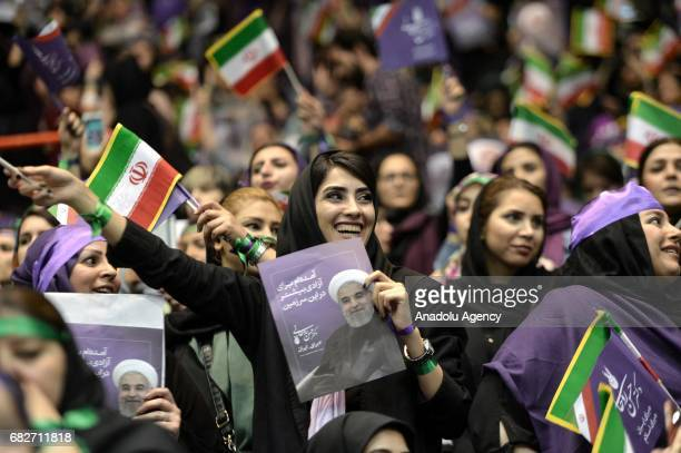 Supporters of Iranian Presidential candidate Hassan Rouhani participate the meeting at Azadi Sport Complex ahead of the presidential elections that...