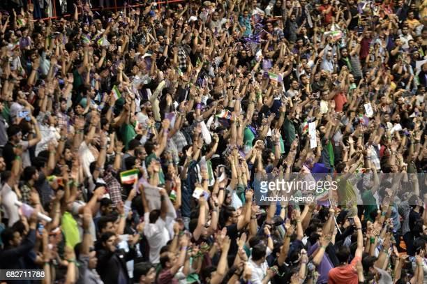 Supporters of Iranian Presidential candidate Hassan Rouhani wave flags during the meeting at Azadi Sport Complex ahead of the presidential elections...