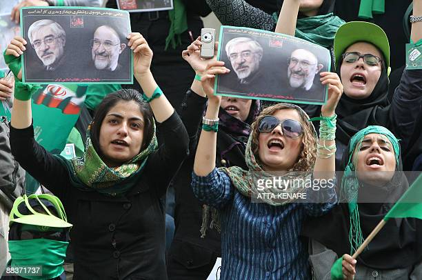 Supporters of Iranian presidential candidate Mir Hossein Mousavi hold his picture with former reformist president Mohammad Khatami during a proreform...