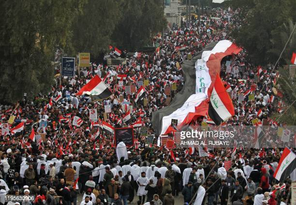"""Supporters of Iraqi cleric Moqtada Sadr gather in the capital Baghdad for a """"million-strong"""" march to demand an end to the presence of US forces in..."""