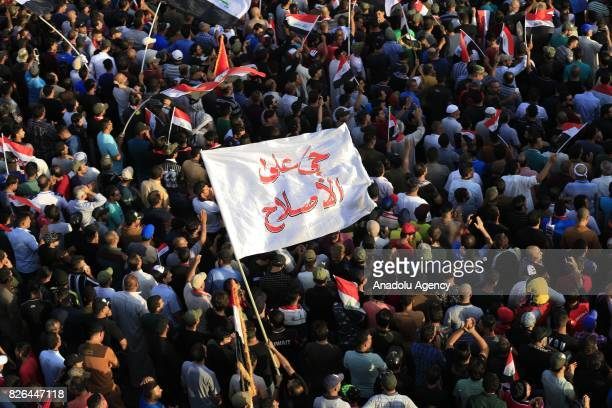 Supporters of Iraqi Shiite cleric Moqtada alSadr attend a demonstration against the new electoral bill of the country prepared for the upcoming Iraqi...