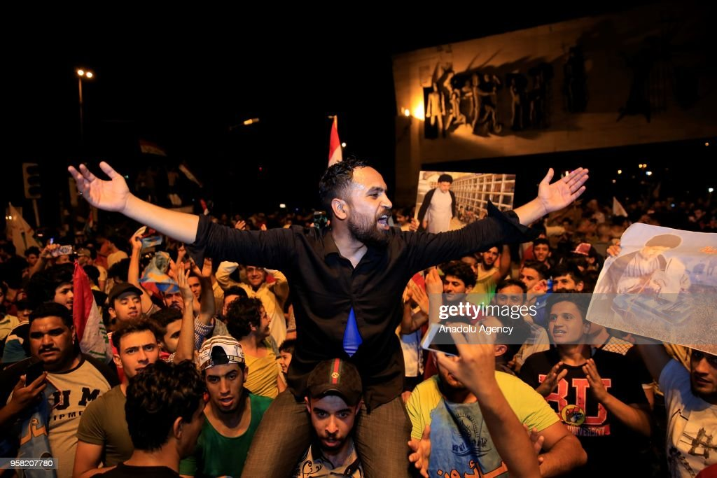 Supporters of Shiite cleric al-Sadr celebrate Election Results in Baghdad : News Photo
