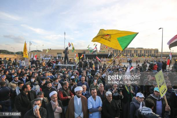 Supporters of Iraq's Hashed al-Shaabi paramilitary force protest outside the US embassy in the Iraqi capital Baghdad on January 1, 2020 to condemn...