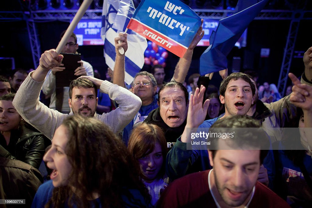 Supporters of Israeli Labor party leader Shelly Yachimovich wave flags during a campaign rally ahead of the upcoming Israeli elections on January 17, 2013 in Tel Aviv, Israel. Israeli elections are scheduled for January 22, and are reportedly showing a majority for the Israeli right.