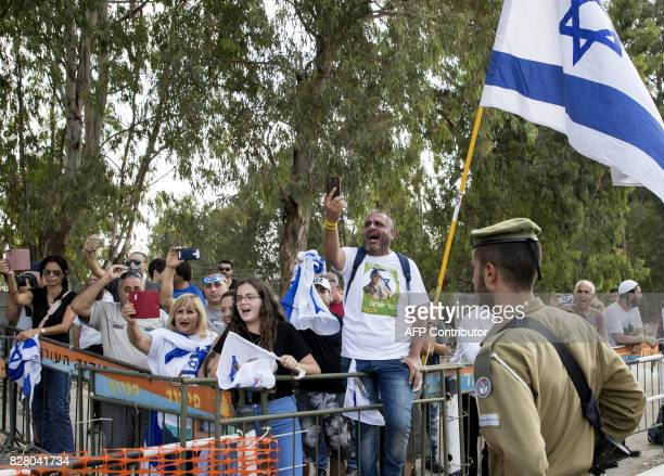 Supporters of Israeli soldier Elor Azaria who was convicted of manslaughter and sentenced to 18 months imprisonment for killing a wounded and...