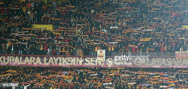 Supporters of Istanbul celebrate during the UEFA Cup Round of 16 second leg match between Galatasaray Istanbul and Hamburger SV at the Ali Sami Yen...