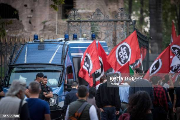 Supporters of Italian farright movement CasaPound march behind a banner reading 'Enough deterioration Close the Mosque' during a protest against a...