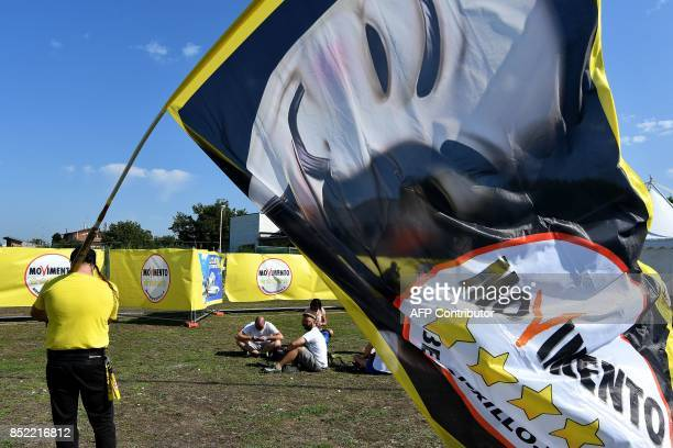Supporters of Italy's populist Five Star Movement wait for the start of the party's congress in Rimini on September 23, 2017. Italy's populist 5-Star...