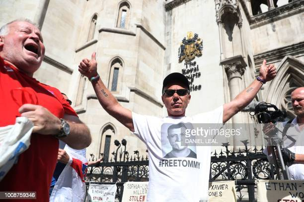 Supporters of jailed English Defence League founder Tommy Robinson real name Stephen YaxleyLennon react outside the Royal Courts of Justice in London...