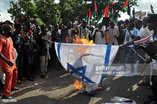 Supporters of jailed Nigerian Shi'a cleric Ibrahim Zakzaky burn an Israeli flag during a demonstration against US and Israeli policies in Abuja on...
