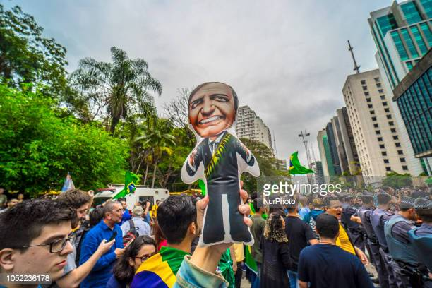 Supporters of Jair Bolsonaro farright lawmaker and presidential candidate of the Social Liberal Party and supporters of Fernando Haddad presidential...