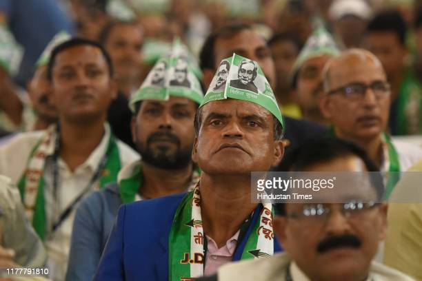 Supporters of Janata Dal United are seen during a training camp for JDU workers and supporters hosted by Chief Minister of Bihar Nitish Kumar, on...