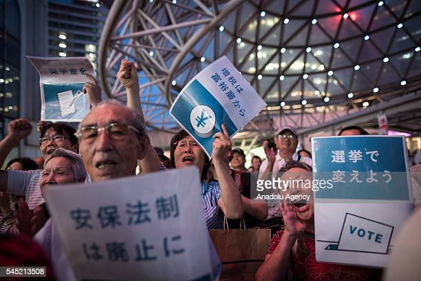 Supporters of Japan Communist Party attend an upper house election campaign rally in Chiba, Japan, 06 July 2016. Japan's upper house election will be...