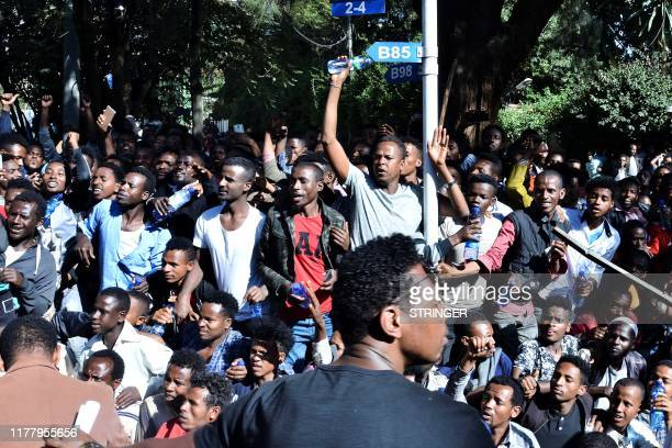Supporters of Jawar Mohammed a member of the Oromo ethnic group who has been a public critic of Abiy gather outside his home in the Ethiopian capital...
