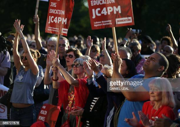 Supporters of Jeremy Corbyn hold up placards and cheer a speaker at a Black Asian and minority ethnic rally in north London on August 15 2016...
