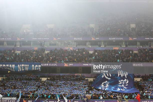 Supporters of Jiangsu Suning cheer during the AFC Champions League 2017 Group H match between Jiangsu Suning and Adelaide United at Nanjing Olympic...
