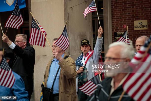 Supporters of Joe Concannon a retired NYPD captain and current candidate for NYC City Council District 23 wave American flags during a 'Support Your...