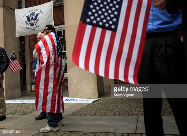 Supporters of Joe Concannon a retired NYPD captain and current candidate for NYC City Council District 23 arrive with American flags before the start...