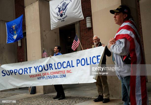 Supporters of Joe Concannon a retired NYPD captain and current candidate for NYC City Council District 23 hold up a banner during a 'Support Your...