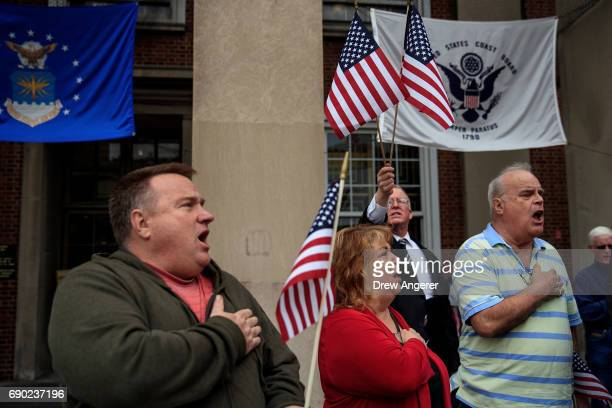 Supporters of Joe Concannon a retired NYPD captain and current candidate for NYC City Council District 23 recite the Pledge of Allegiance during a...