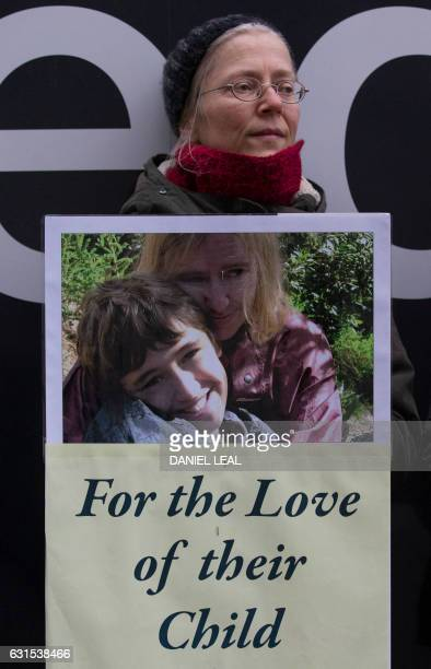 A supporters of John Letts and Sally Lane parents of Jack Letts who is believed to have left the UK to join Islamic State holds a placard outside the...