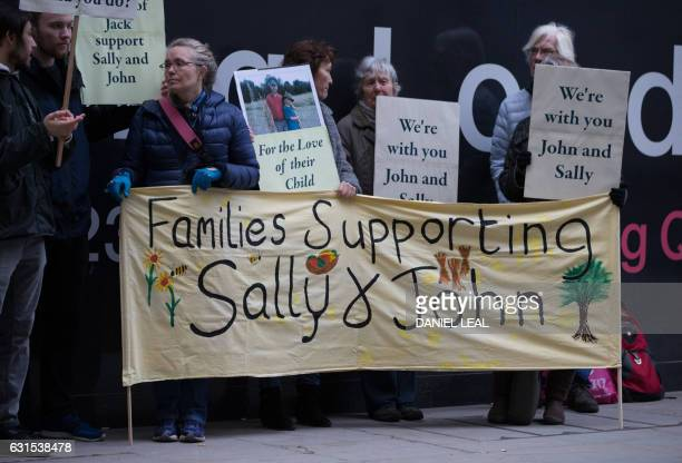Supporters of John Letts and Sally Lane parents of Jack Letts who is believed to have left the UK to join Islamic State hold banners outside the Old...