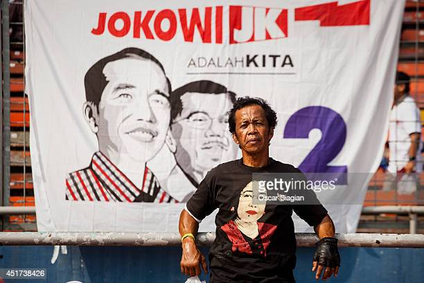 Supporters of Joko Widodo attend a campaign rally on July 5 2014 in Jakarta Indonesia Today marks the last day of campaigning ahead of Indonesia's...