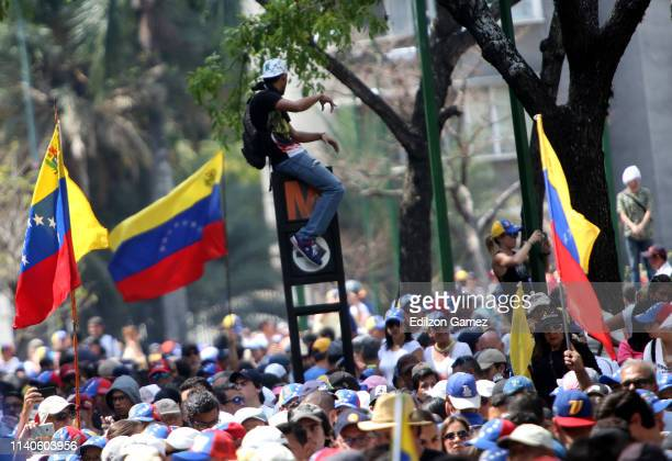 Supporters of Juan Guaido hold flags of Venezuela during the May 1 demonstration at plaza Altamira on May 1 2019 in Caracas Venezuela Yesterday...