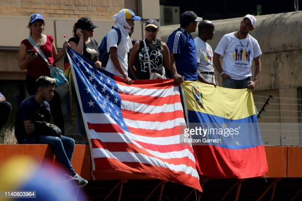 Supporters of Juan Guaido show flags of United States and Venezuela during the May 1 demonstration at plaza Altamira on May 1 2019 in Caracas...