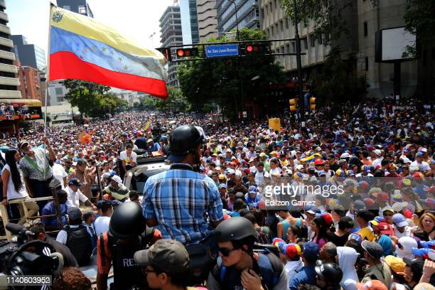 Supporters of Juan Guaido show flags of Venezuela during the May 1 demonstration at plaza Altamira on May 1, in Caracas, Venezuela. Yesterday,...