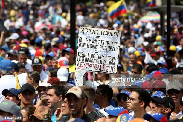 Supporters of Juan Guaido show signs during the May 1 demonstration at plaza Altamira on May 1 2019 in Caracas Venezuela Yesterday Venezuelan...