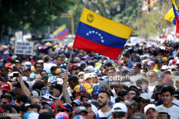 Supporters of Juan Guaido wave a flag of Venezuela during the May 1 demonstration at plaza Altamira on May 1, 2019 in Caracas, Venezuela. Yesterday,...