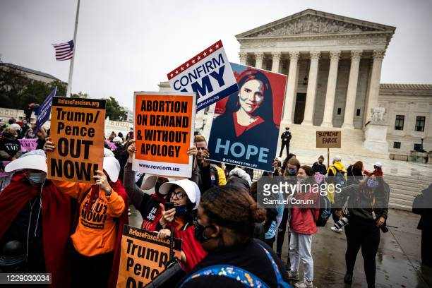 Supporters of Judge Amy Coney Barrett attempt to block and drown out pro-choice supporters outside of the US Supreme Court the morning that the...