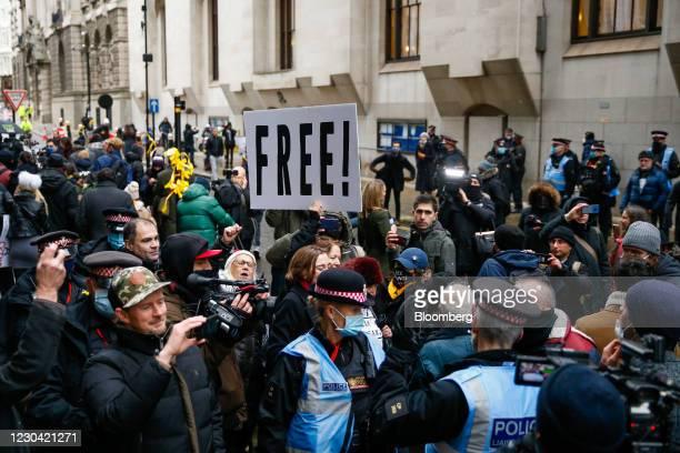 Supporters of Julian Assagne, founder Wikileaks, celebrate outside the Old Bailey court in London, U.K., on Monday, Jan. 4, 2021. A London judge...
