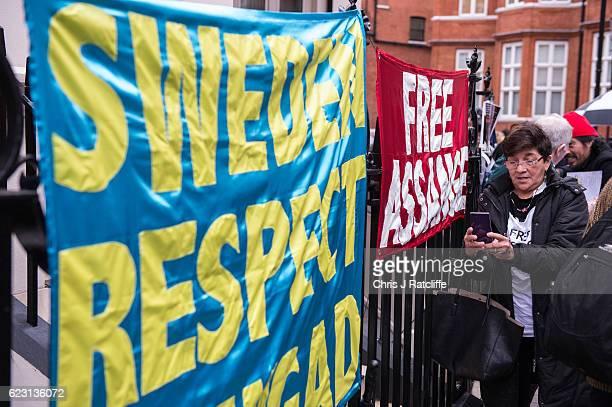 Supporters of Julian Assange hang banners opposite the Embassy of Ecuador as Swedish prosecutors question Wikileaks founder Julian Assange on...