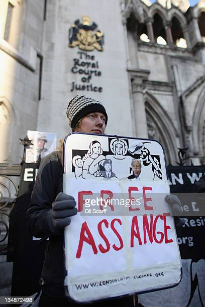 Supporters of Julian Assange the founder of the whistleblowing 'WikiLeaks' website demonstrate outside the High Court on December 5 2011 in London...