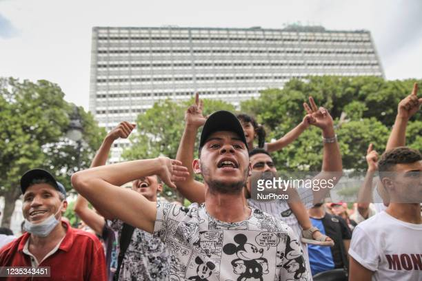 Supporters of Kais Saied gesture as they shouts slogans as they stand in front of a demonstration held in the capital Tunis, Tunisia, on September 18...