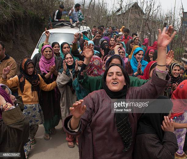 Supporters of Kashmir's main opposition political party Peoples Democratic Party's leader Mehbooba Mufti and candidate for South Kashmir dance and...