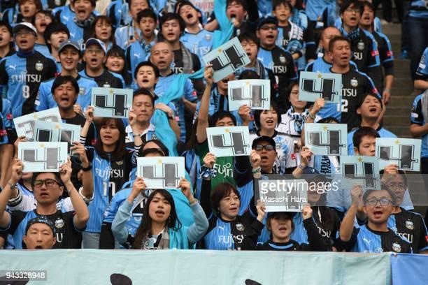 Supporters of Kawasaki Frontale cheer Yoshito Okubo prior to the JLeague J1 match between Yokohama FMarinos and Kawasaki Frontale at Nissan Stadium...