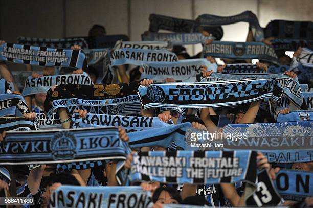 Supporters of Kawasaki Frontale hold mufflers prior to the J.League match between Kawasaki Frontale and Ventforet Kofu at the Todoroki Stadium on...
