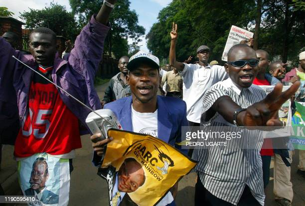 Supporters of Kenyan opposition National Rainbow Coalition candidate Mwai Kibaki celebrate in the streets of Nairobi 29 December 2002 Acording to the...
