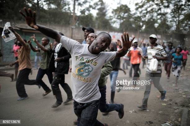 Supporters of Kenyan opposition presidential candidate Raila Odinga take part in a march in the Mathare slum in Nairobi on August 10 following an...