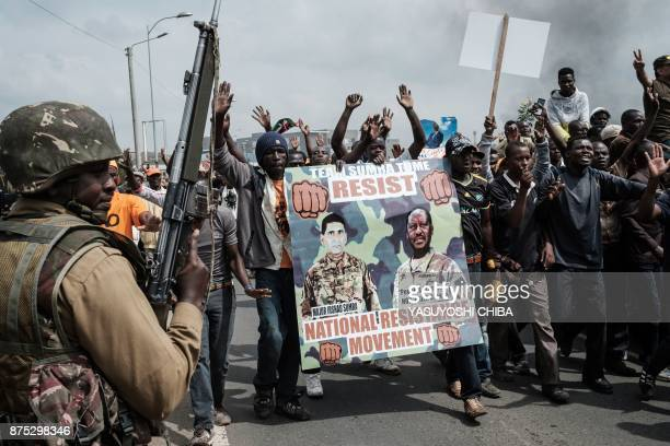 Supporters of Kenyan's opposition party National Super Alliance carry banners during a demonstration during the arrival of opposition leader Raila...