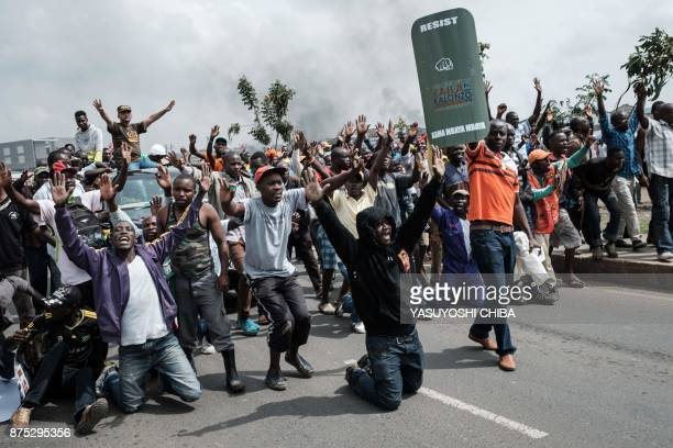 TOPSHOT Supporters of Kenyan's opposition party National Super Alliance react when confronted by Kenyan police as they attempt to march towards the...